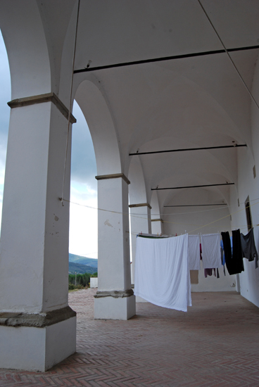 The laundry is left by the tenants who rent out extra space in the monastery.  Everything here seems to be multi-purpose.
