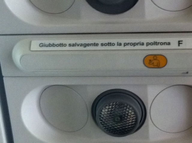 I don't read Italian, but I'm quite sure that sign doesn't require me to fasten and unfasten an elderly woman's seat belt every time she wants to go to the bathroom.