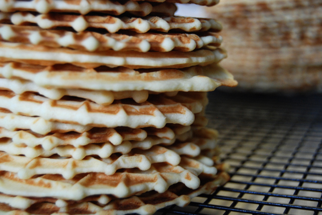 Piles and piles of pretty pizzelles.